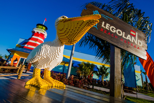 """WINTER HAVEN, Fla. (April 7, 2017) — Summer vacation lasts all year long at LEGOLAND® Beach Retreat, all-new accommodations that give guests great new reasons to play — and stay — at LEGOLAND Florida Resort. Filled with creative LEGO® theming inside and out, the village-style vacation resort features brightly colored bungalows grouped into 13 horseshoe-shaped """"coves"""" named after popular LEGO Minifigures. The fun begins almost immediately, thanks to a drive-through check-in process that will take you from your car to your cove in minutes. This speedy service makes staying at LEGOLAND Beach Retreat as carefree as a day at the beach. Designed to look like larger-than-life LEGO sets, 83 bungalows offer 166 separate rooms that sleep up to five, including a cozy area just for kids with a bunk bed, trundle bed and privacy curtain. They're an ideal solution for families and groups traveling together, or for those seeking a fun new way to vacation at LEGOLAND Florida Resort. Each cove has its own outdoor play area within view of the bungalows' shaded patios, where mom and dad can relax while kids romp and run. (PHOTO / Chip Litherland, LOCK + LAND)"""