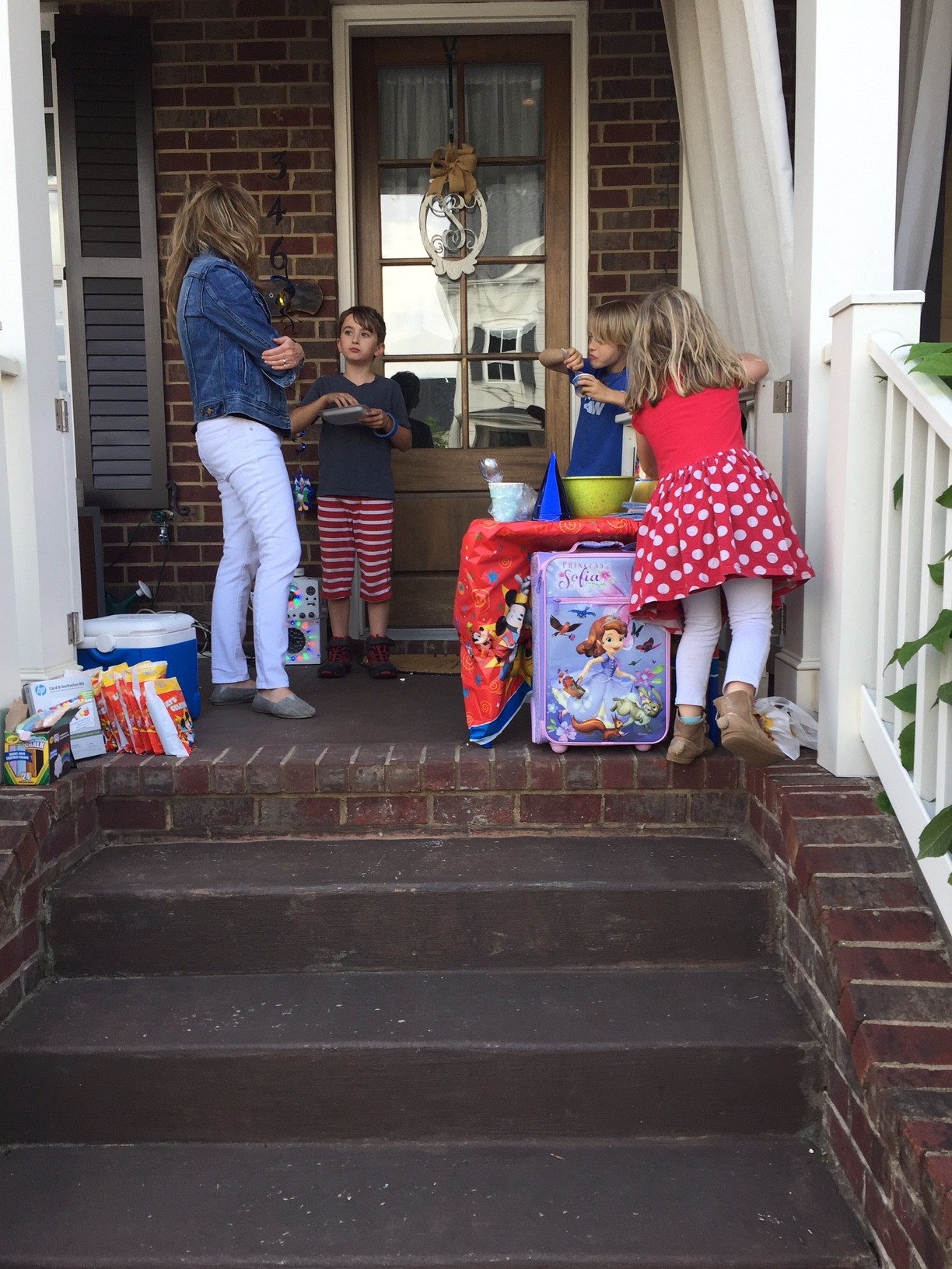 #DisneyKids Flash Playdate. Woman and children on a porch with party items.